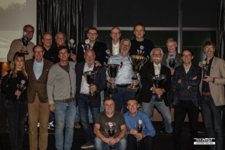 During a well-attended meeting in Houten, the Catawiki NK HTGT 2019 champions were honoured. There were trophies for the top 3 finishers in each class, adding up to a huge number in all. Fortunutaly this did not faze MC Egbert Kolvoort as he is never lost for words. Next, it was time for serious business, the overall trophies. The cup for third place was awarded to Ford Falcon pilot Norbert Gross. The second place trophy went to the veteran duo of Martin Bijleveld and Jaap van der Ende, who have been racing their Ford Falcon for many years. Overall winner and the 2019 Dutch pre-'66 Champion, with an unbroken series of class victories in his Porsche 911, is Erwin van Lieshout. In addition to the trophy for the championship, Erwin was presented with the NK HTGT challenge cup by 2018 champion Brian Lambert. The Michel Oprey challenge trophy was awarded by Michiel Campagne, as always to the most consistent driver of the year. The prize went to a duo this year: Jaap van der Ende and Martin Bijleveld recorded the most consistent lap times over the season. This led Martin to conclude that he should up his pace a bit! Tire supplier HP Tires surprised Erwin van Lieshout and the Bijleveld / v.d. Ende pairing with a number of free Dunlop Racing tires. NK HTGT Chairman Bert Mets was buoyant about the 2020 race schedule, with rounds at Hockenheim, Zandvoort, Spa, Zolder, Assen and Le Mans. Thanks to new title sponsor Nolte Kitchens and the continued support of Gamma, registration fees for 2020 have remained unchanged. There are already 30 drivers registered for a full season of racing, including four new entrants from Sweden. Package deals are still available, mail to race@nkhtgt.nl for more information.